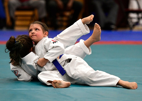 7/21/2018 Mike Orazzi | Staff Josephina Fox (looking up) and Mackenzie Dunn during the Nutmeg Games Judo held at New Britain High School Saturday morning.