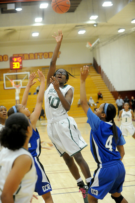 . 02-23-2012--(LANG Staff Photo by Sean Hiller)- Narbonne beat El Camino Real 47-39 in Saturday\'s L.A. City Section Division I semifinal girls basketball game. Narbonne\'s Lauryn Catching (10) gets the basket over El Camino\'s 	Sasha Samuels (32) ,left, and 	Sukari Richardson (4).