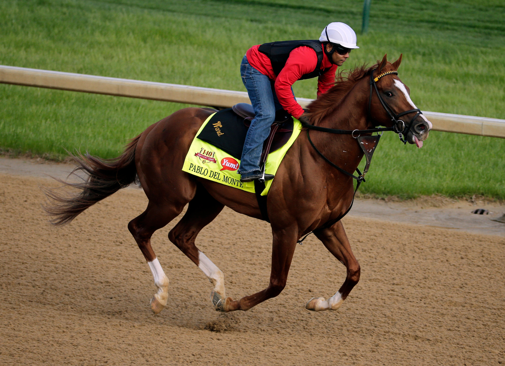 . An exercise rider takes Kentucky Derby hopeful Pablo Del Monte for a morning workout at Churchill Downs Thursday, May 1, 2014, in Louisville, Ky. (AP Photo/Charlie Riedel)