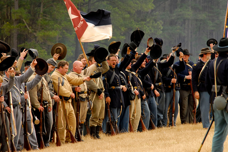 Confederate and Union reenactors celebrate at the conclusion of the battle reenactment. The Skirmish at Gamble's Hotel happened on March 5, 1885 when 500 federal soldiers, under the command of Reuben Williams of the 12th Indiana Infantry, marched into Florence to destroy the railroad depot but were met by Confederate soldiers backed up with 400 militia. The reenactment, held by the 23rd South Carolina Infantry, was held at the Rankin Plantation in Florence, South Carolina on Saturday, March 5, 2011. Photo Copyright 2011 Jason Barnette