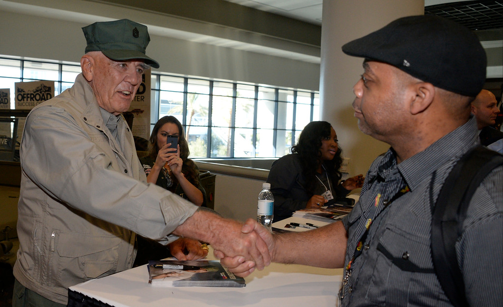 . Nov 6,2013 Las Vegas NV. USA.  Actor Ronald Lee Ermey best known for his role as Gunnery Sergeant Hartman in Full Metal Jacket, signs signs autographs at the Off road success center during the second day of the 2013 SEMA auto show. Photo by Gene Blevins/LA Daily News