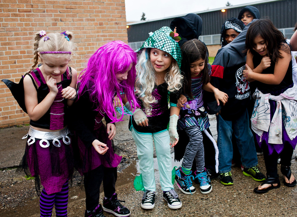 . Students from Flushing Middle School participate an annual Halloween costume contest before classes on Thursday, Oct 31, 2013, at Flushing Middle School, in Flushing, Mich. (AP Photo/The Flint Journal, Zack Wittman)