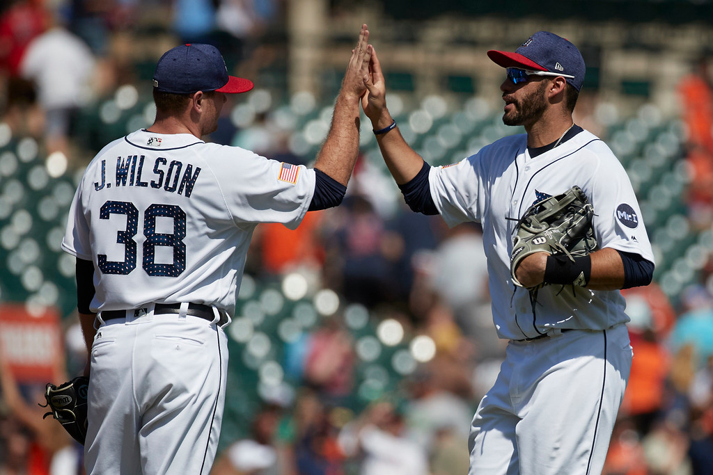 . Detroit Tigers relief pitcher Justin Wilson (38) and right fielder J.D. Martinez (28)  celebrate after their 7-4 win against the Cleveland Indians in the first baseball game of a doubleheader in Detroit, Saturday, July 1, 2017. (AP Photo/Rick Osentoski)