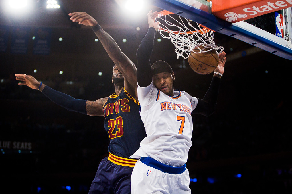. New York Knicks\' Carmelo Anthony, right, dunks next to Cleveland Cavaliers\' LeBron James during the second half of an NBA basketball game, Saturday, Feb. 4, 2017, in New York. (AP Photo/Andres Kudacki)