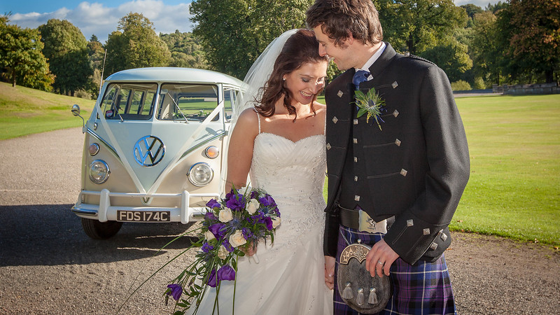 Wedding Photography of Laura & Barry, Callander House in Callander Park, Falkirk, Phography is of the Bride & Groom standing in the sun in front of a vintage Volkswagan campervan