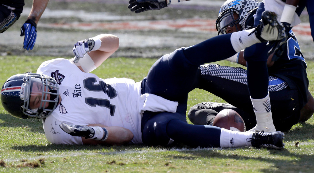 . Rice quarterback Taylor McHargue (16) fumbles the ball after he was hit by Air Force defensive back Steffon Batts (23) during the first half of the Armed Forces Bowl NCAA college football game Saturday, Dec. 29, 2012, in Fort Worth, Texas. McHargue left the game with a concussion on the play.  (AP Photo/LM Otero)