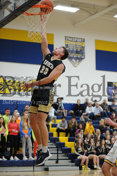 Knoch #33 Jake Schiedt goes for the dunk against Freeport during a game at Freeport Gym on Tuesday January 14, 2020 (Jason Swanson photo)