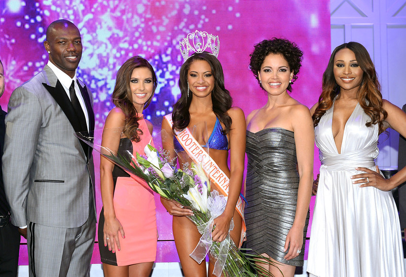 . Former NFL player and pageant judge Terrell Owens, television personality and pageant judge Audrina Patridge, Marissa Raisor of Newport, Kentucky, Miss USA 2003 and pageant judge Susie Castillo and model and pageant judge Cynthia Bailey pose onstage after Raisor was crowned Miss Hooters International 2013 at the 17th annual Hooters International Swimsuit Pageant at The Joint inside the Hard Rock Hotel & Casino on June 27, 2013 in Las Vegas, Nevada.  (Photo by Ethan Miller/Getty Images)