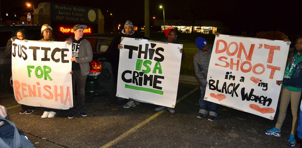 . Teens created signs for the protest outside of the Dearborn Heights police station Thursday evening.