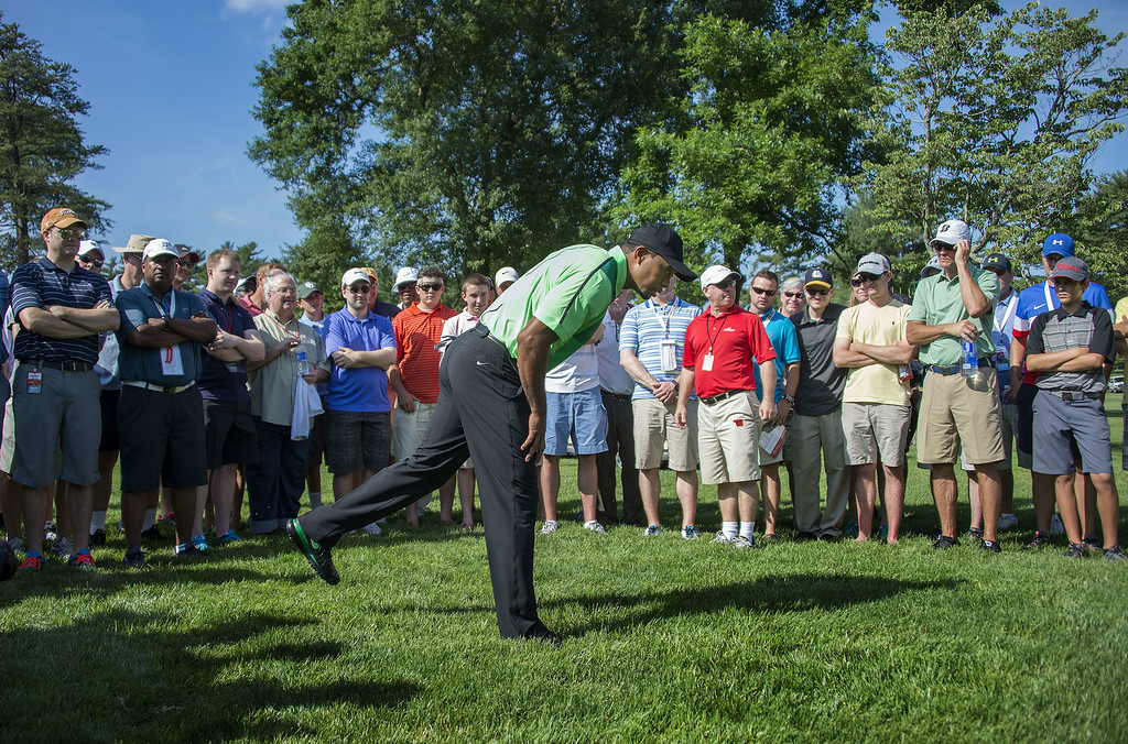 . US golfer Tiger Woods looks for his ball in the rough during the first round of the Quicken Loans National at Congressional Country Club in Bethesda, MD, June 26, 2014. JIM WATSON/AFP/Getty Images