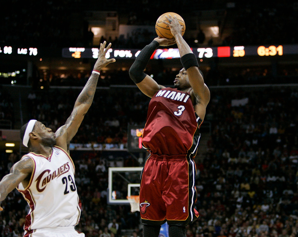. Miami Heat\'s Dwyane Wade (3) shoots over Cleveland Cavaliers\' LeBron James during an NBA basketball game Sunday, Dec. 28, 2008, in Cleveland. (AP Photo/Mark Duncan)