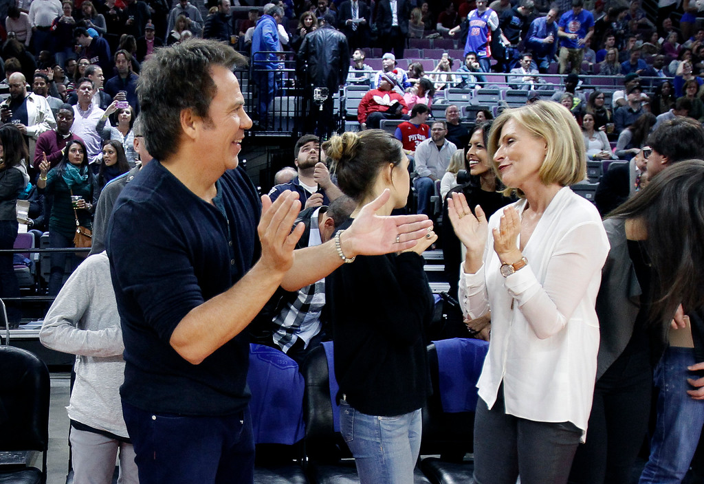 . Detroit Pistons owner Tom Gores, left, with his wife Holly, right, applauds while celebrating the season opener NBA basketball game against the Brooklyn Nets Saturday, Nov. 1, 2014, in Auburn Hills, Mich. (AP Photo/Duane Burleson)