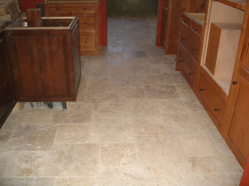 After the grout has been applied, it looks like a completely different floor, no longer quite as rough and coarse.