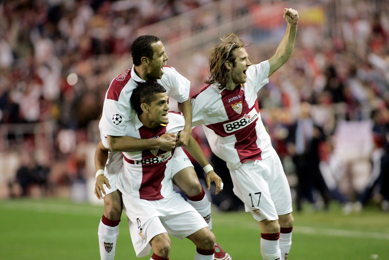 Daniel Alves, Luis Fabiano and Diego Capel celebrating a goal. UEFA Champions League first knockout round game (second leg) between Sevilla FC (Seville, Spain) and Fenerbahce (Istambul, Turkey), Sanchez Pizjuan stadium, Seville, Spain, 04 March 2008.