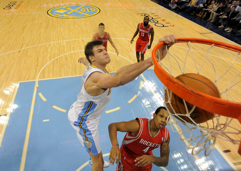 . DENVER, CO. - JANUARY 30: Denver Nuggets small forward Danilo Gallinari (8) flies to the basket for a big dunk over Houston Rockets power forward Greg Smith (4) during the fourth quarter January 30, 2013 at Pepsi Center. Danilo Gallinari led in scoring with 27 points. The Denver Nuggets take on the Houston Rockets in NBA action. (Photo By John Leyba/The Denver Post)