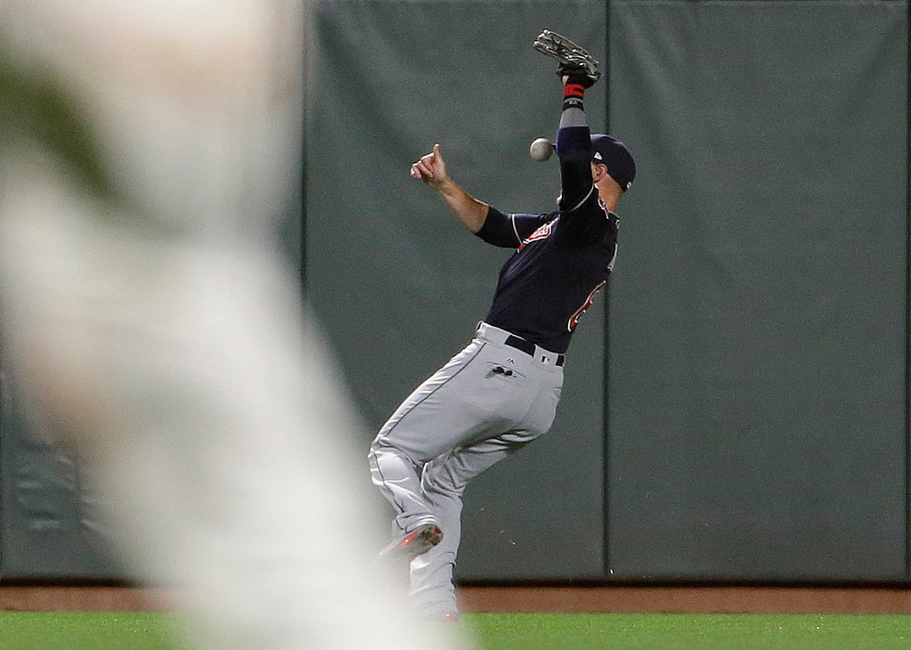 . Cleveland Indians right fielder Brandon Guyer commits an error on a fly ball hit by San Francisco Giants\' Eduardo Nunez during the sixth inning of a baseball game in San Francisco, Tuesday, July 18, 2017. (AP Photo/Jeff Chiu)