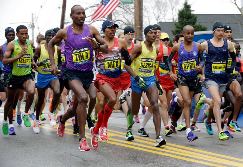 . From left, Yemane Adhane Tsegay of Ethiopia, Wesley Korir of Kenya, Tadese Tola of Ethiopia, Meb Keflezighi of San Diego, Lelisa Desisa of Ethiopia, Lusapho April of South Africa, and Nicholas Arciniaga of Flagstaff, Ariz., leave the start line of the Boston Marathon, Monday, April 20, 2015, in Hopkinton, Mass. (AP Photo/Stephan Savoia)