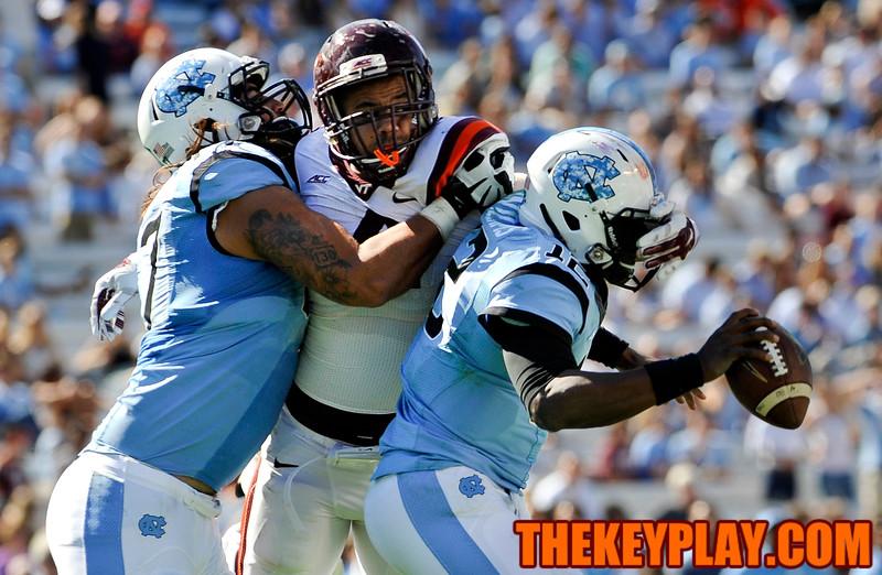Virginia Tech Hokies defensive end Ken Ekanem (4) escapes his block to hit and bring down North Carolina Tar Heels quarterback Marquise Williams (12). (Michael Shroyer/ Thekeyplay.com)