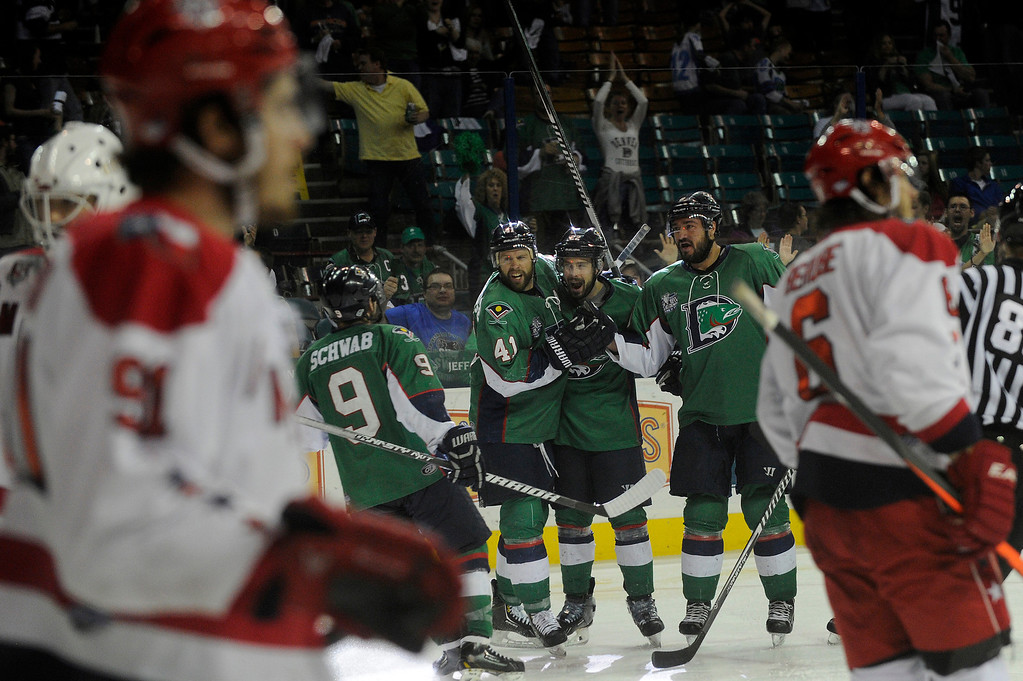 . DENVER, CO - MAY 2: The Denver Cutthroats celebrate their fourth goal of the night during the third period of game 1 of the Ray Miron Presidents Cup Finals at the Denver Coliseum in Denver, Colorado on May 2, 2014. (Photo by Seth McConnell/The Denver Post)