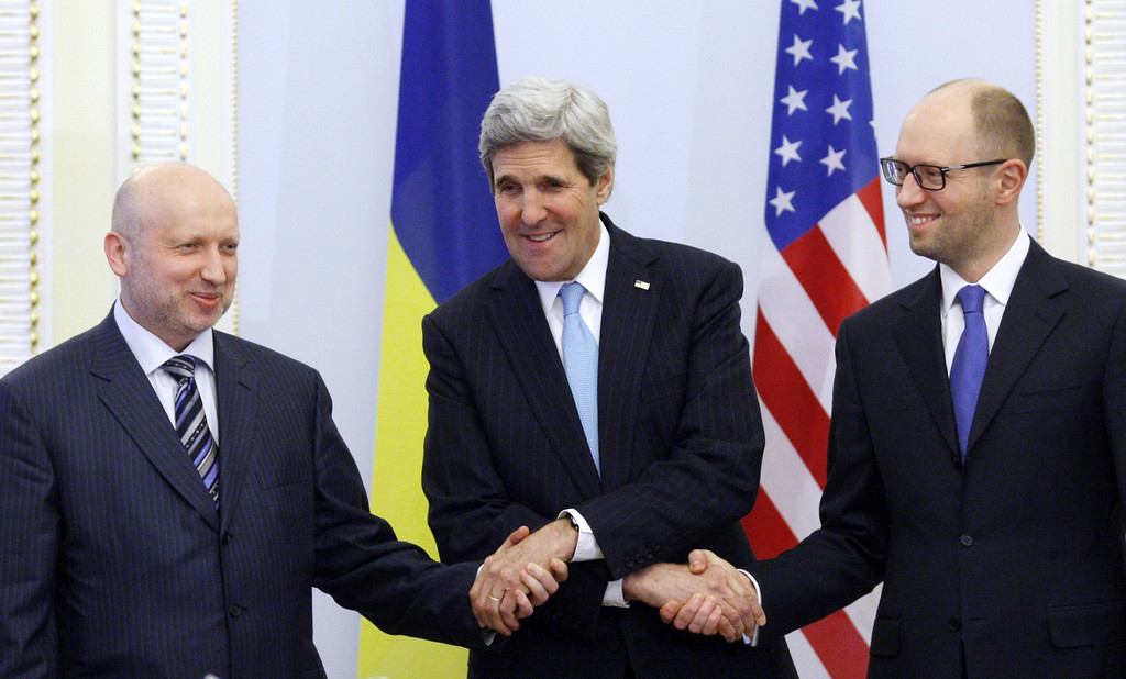 . US Secretary of State John Kerry (C), Oleksandr Turchynov, Parliament Speaker and Ukraine\'s interim President (L) and the Prime Minister Arseniy Yatsenyuk shake hands during their talks in Kiev on March 4, 2014. Kerry arrived in Kiev for talks with Ukraine\'s new interim government, amid an escalating crisis in Crimea. AFP PHOTO/ YURY KIRNICHNY/AFP/Getty Images