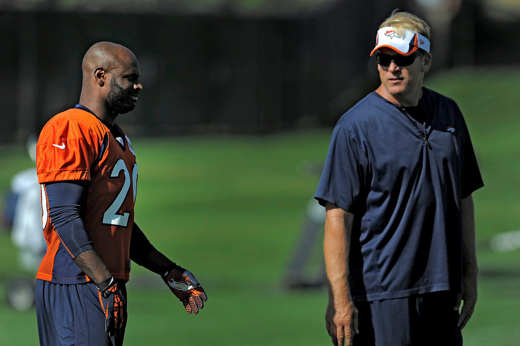 . Denver Broncos defensive coordinator talks with Denver Broncos strong safety Mike Adams (20) during practice  September 9, 2013 at Dove Valley. (Photo by John Leyba/The Denver Post)