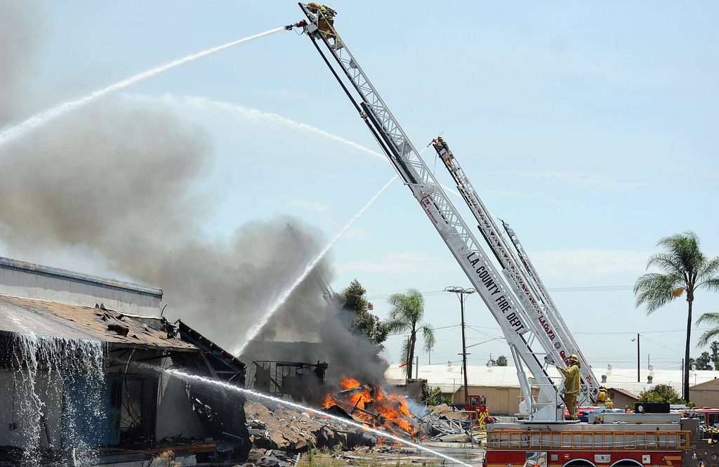. Los Angeles County firefighters from across the valley battle a 3-alarm fire at an abandoned warehouse near 9th Avenue and Clark Avenue on Tuesday, July 9, 2013 in City of Industry, Calif.  (Keith Birmingham/Pasadena Star-News)