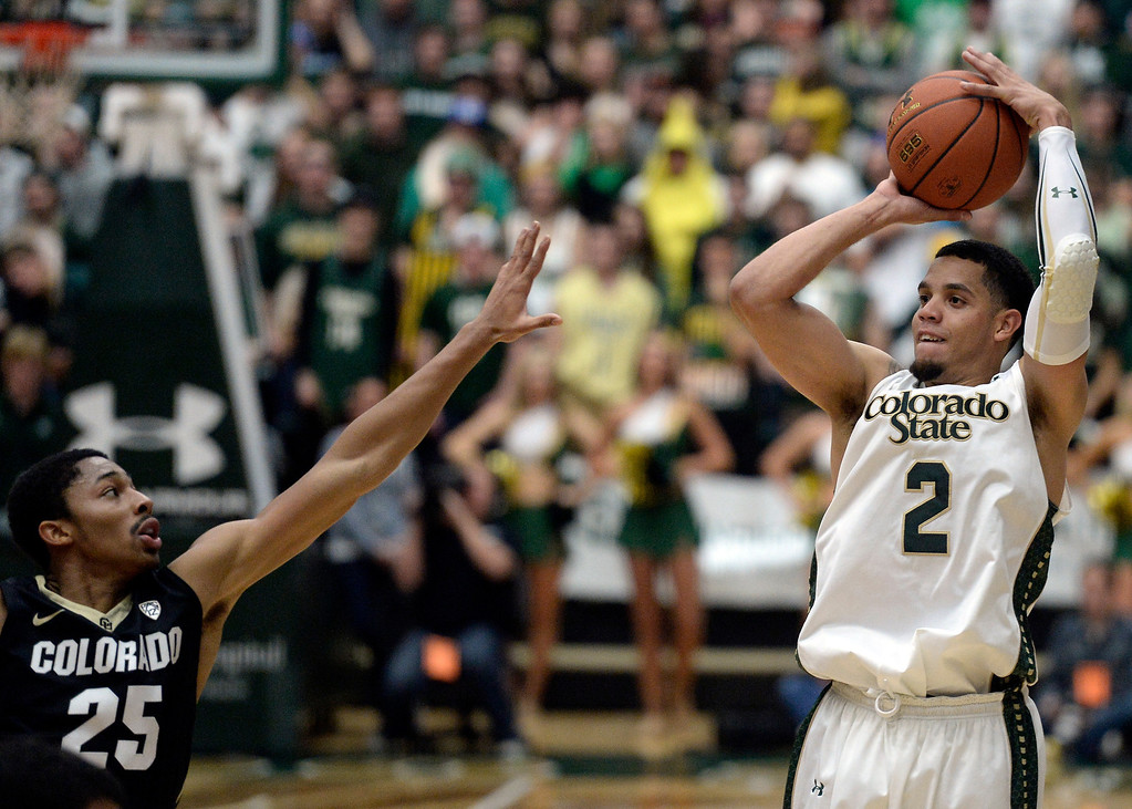. CSU\'s  Marcus Holt takes a shot over Spencer Dinwiddie during an NCAA game against CU on Tuesday, Dec. 3, 2013, at the Moby Arena in Fort Collins. Jeremy Papasso/ Camera
