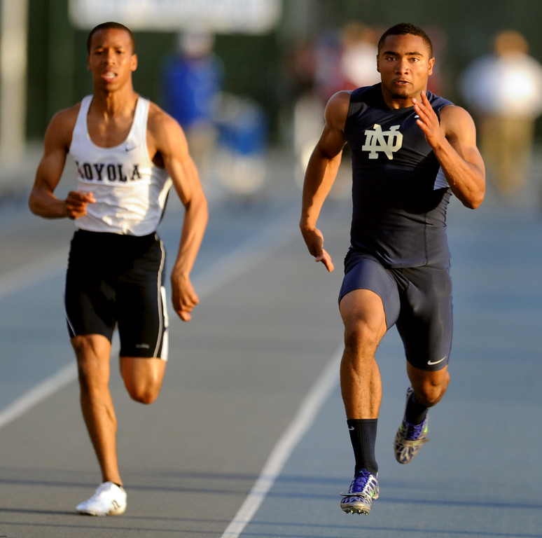 . Notre Dame\'s Khalfani Muhammad wins the 100 meter dash during the CIF-SS Masters Meet at Cerritos College on Friday, May 24, 2013 in Norwalk, Calif.  (Keith Birmingham Pasadena Star-News)