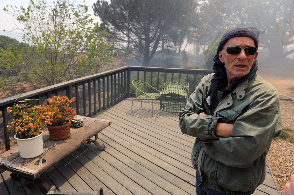 . Deer Creek Road resident Brian Evering watches the action from a deck in Ventura County, Friday, May 3, 2013. (Michael Owen Baker/Los Angeles Daily News)