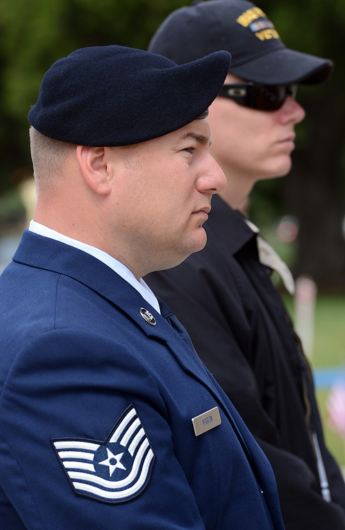 . Jason Mabon, left, an Air Force Reservist and Iraqi War Veteran Dustin Murphy, both University of Redlands students listen to speakers during a memorial service for fallen service members was held Friday May 17, 2013 in front of the Memorial Chapel at the university. The ceremony featured a special tribute to Keith Taylor, a University of Redlands alumnus and father of a University of Redlands student. He was killed serving in Iraq. (Rick Sforza/Staff photographer, Redlands Daily Facts)