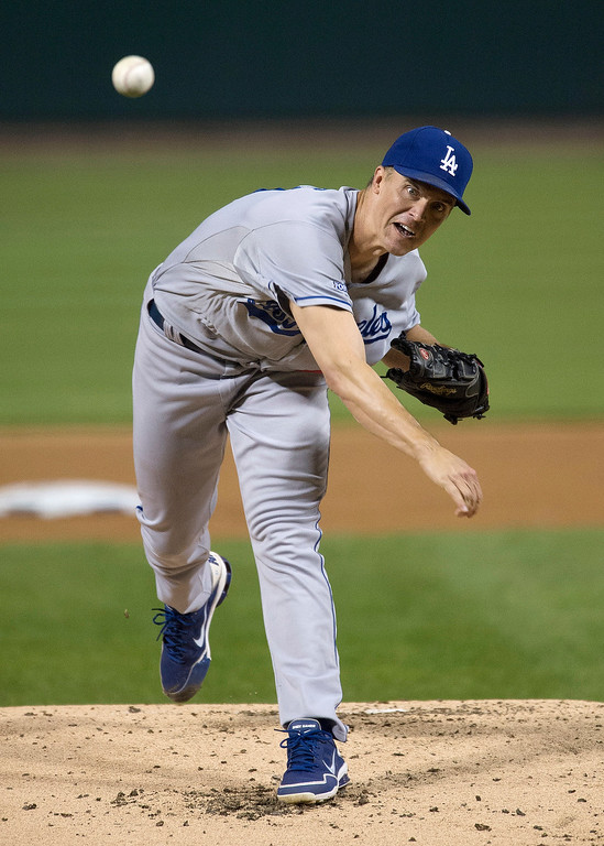 . Los Angeles Dodgers starting pitcher Zack Greinke throws during the first inning of Game 1 of the National League baseball championship series against the St. Louis Cardinals, Friday, Oct. 11, 2013, in St. Louis. (AP Photo/Al Tielemans, Pool)