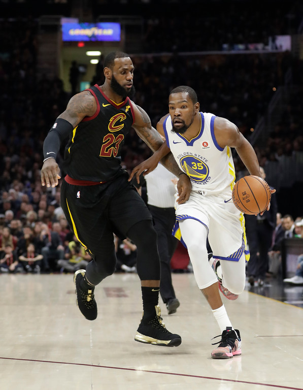 . Golden State Warriors\' Kevin Durant goes to the basket against Cleveland Cavaliers\' LeBron James during the first half of Game 4 of basketball\'s NBA Finals, Friday, June 8, 2018, in Cleveland. (AP Photo/Tony Dejak)