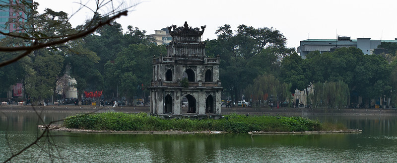 """Thap Rua, or Tortoise Tower, is a three-story pagoda located in the middle of  Hoàn Kiếm Lake.  It was built in the 18th century, and is one of the most recognized landmarks in Hanoi.  Hanoi has been inhabited since at least 3000 BC. One of the first known permanent settlements is the Co Loa citadel (Cổ Loa) founded around 200 BC.  Hanoi has had many names throughout history, all of them of Sino-Vietnamese origin. During the Chinese domination of Vietnam, it was known as Tống Bình (宋平) and later Long Đỗ (龍肚; literally """"dragon's belly""""). In 866, it was turned into a citadel and was named Đại La (大羅).  In 1010, Lý Thái Tổ, the first ruler of the Lý Dynasty, moved the capital of Đại Việt (大越, the Great Viet, then the name of Vietnam) to the site of the Đại La Citadel. Claiming to have seen a dragon ascending the Red River, he renamed it Thăng Long (昇龍, English: Ascending dragon) - a name still used poetically to this day. It remained the capital of Vietnam until 1397, when the capital was moved to Thanh Hóa, also known as%"""