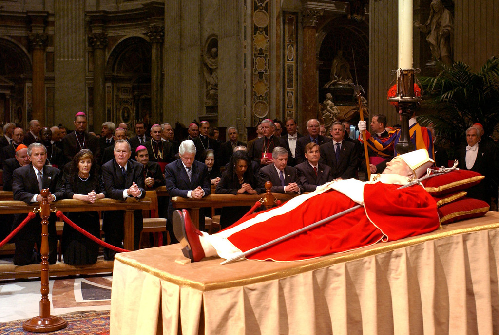 . In this photo made available by the Vatican newspaper Osservatore Romano, front row from left, US President George W. Bush, his wife Laura, his father former President George H.W. Bush, former President Bill Clinton and Secretary of State Condoleezza Rice, kneel  by the body of late Pope John Paul II as he lies in state inside St. Peter\'s Baslica, at the Vatican, Wednesday, April 6, 2005. They  will attend his funeral on Friday. (AP Photo/Osservatore Romano,ho)