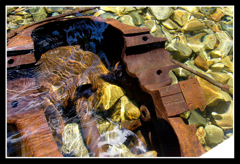 Rock crushing machinery fallen into the lake.