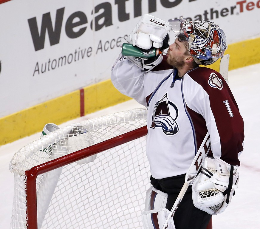 . Colorado Avalanche goalie Semyon Varlamov (1) gets a drink during a break in the action during the third period of an NHL hockey game against the Chicago Blackhawks Tuesday, Jan. 6, 2015, in Chicago. The Avalanche won 2-0. (AP Photo/Charles Rex Arbogast)