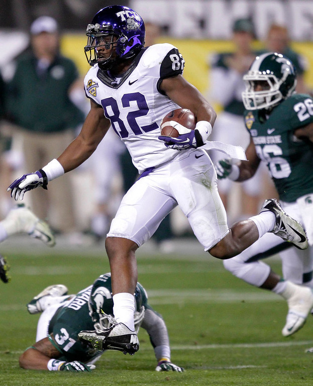 . TCU wide receiver Josh Boyce (82) picks up a first down against Michigan State during the first half of the Buffalo Wild Wings Bowl NCAA college football game, Saturday, Dec. 29, 2012, in Tempe, Ariz. (AP Photo/Matt York)