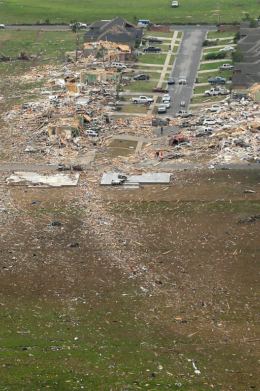. A trail of debris, bottom, leads along the path of a tornado-devastated neighborhood in Vilonia, Ark., Monday, April 28, 2014, after a tornado struck the town late Sunday.  (AP Photo/Danny Johnston)