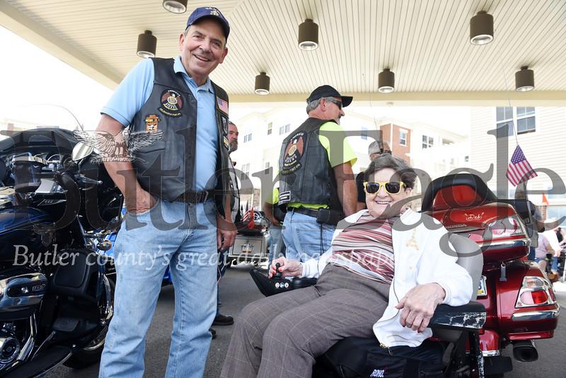 Harold Aughton/Butler Eagle: Arthur Terracio of the American Legion Riders talks with Elma Buttermore, 95, of Lutheran SeniorLife Passavant Community after her motocycle ride, Saturday, August 10.