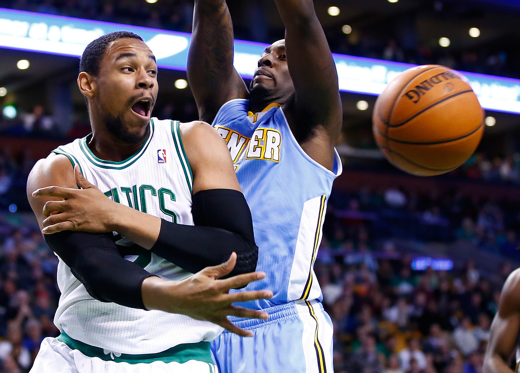 . BOSTON, MA - DECEMBER 06: Jared Sullinger #7 of the Boston Celtics passes the ball underneath the basket against the Denver Nuggets during the game at TD Garden on December 6, 2013 in Boston, Massachusetts.  (Photo by Jared Wickerham/Getty Images)
