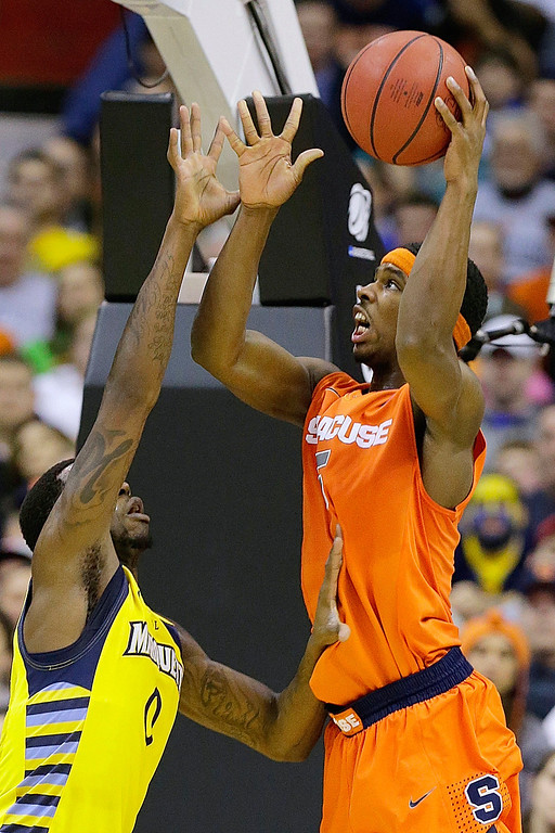 . Syracuse forward C.J. Fair (5) shoots over Marquette forward Jamil Wilson (0) during the second half of the East Regional final in the NCAA men\'s college basketball tournament, Saturday, March 30, 2013, in Washington. (AP Photo/Alex Brandon)