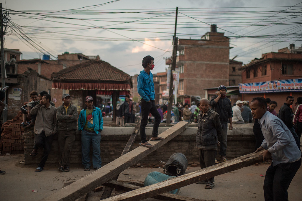 . Nepalese earthquake victims block a street as they protest against the lack of help from the Nepalese Government on April 29, 2015 in Bhaktapur, Nepal. A major 7.8 earthquake hit Kathmandu mid-day on Saturday, and was followed by multiple aftershocks that triggered avalanches on Mt. Everest that buried mountain climbers in their base camps. Many houses, buildings and temples in the capital were destroyed during the earthquake, leaving over 5000 dead and many more trapped under the debris, as emergency rescue workers attempt to clear debris and find survivors. Regular aftershocks have hampered recovery missions as locals, officials and aid workers attempt to recover bodies from the rubble.  (Photo by David Ramos/Getty Images)