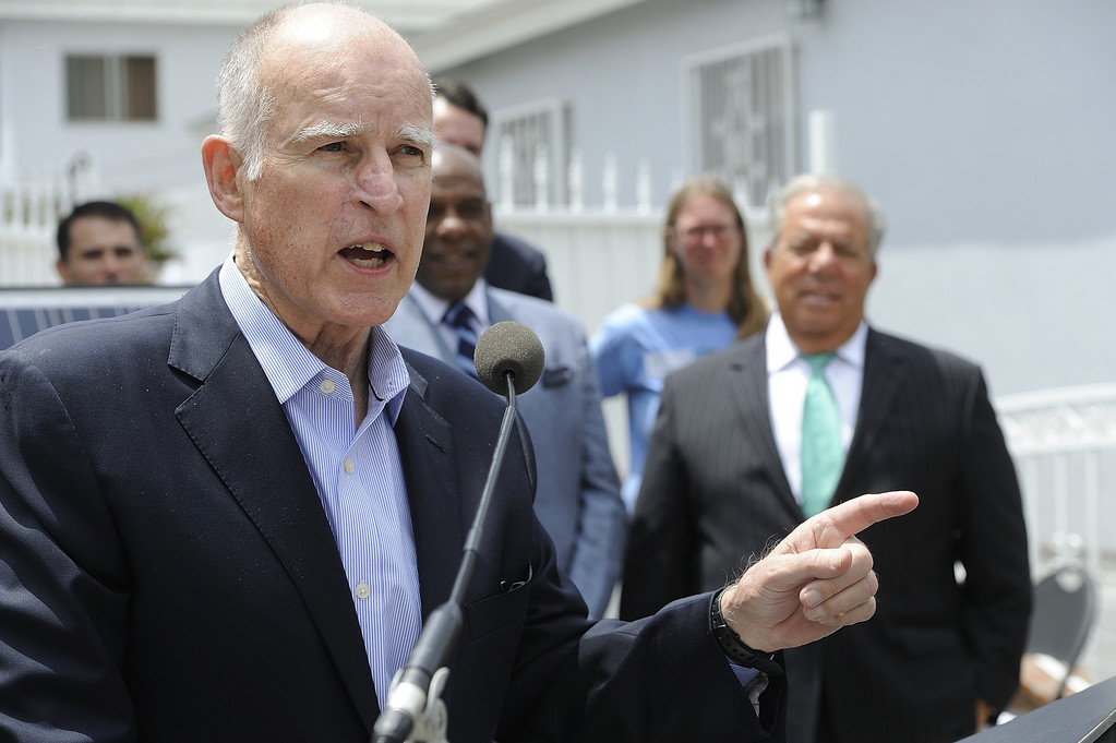 . LONG BEACH, CALIF. USA -- Gov. Jerry Brown speaks at a north Long Beach (Calif.) home during a solar installation on Friday, May 17, 2013. This is the sixth family on this North Long Beach block to be assisted by the Single-family Affordable Solar Homes Program. This installation will allow the homeowners to save up to 90% on their electricity bills. Photo by Jeff Gritchen / Los Angeles Newspaper Group