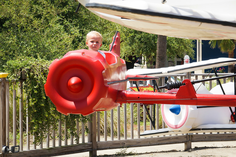 "Luca loved ""flying"" the planes so much he went on the ride twice.  He liked pushing the stick forward to make the plane go down and back to make it go up."