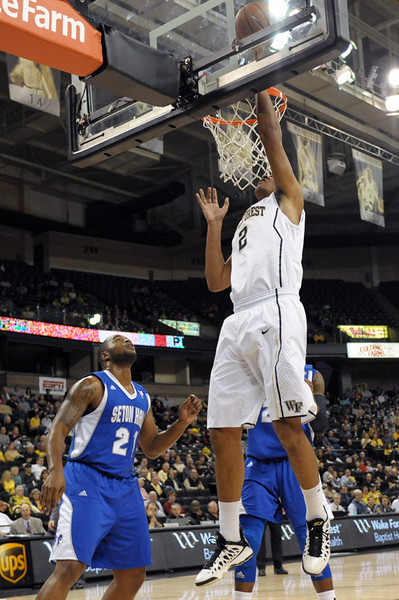 Devin Thomas shot under basket.jpg