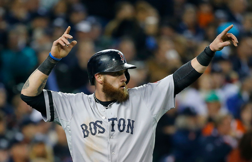 . Boston Red Sox\'s Jonny Gomes reacts after scoring in the second inning during Game 5 of the American League baseball championship series against the Detroit Tigers, Thursday, Oct. 17, 2013, in Detroit. (AP Photo/Paul Sancya)