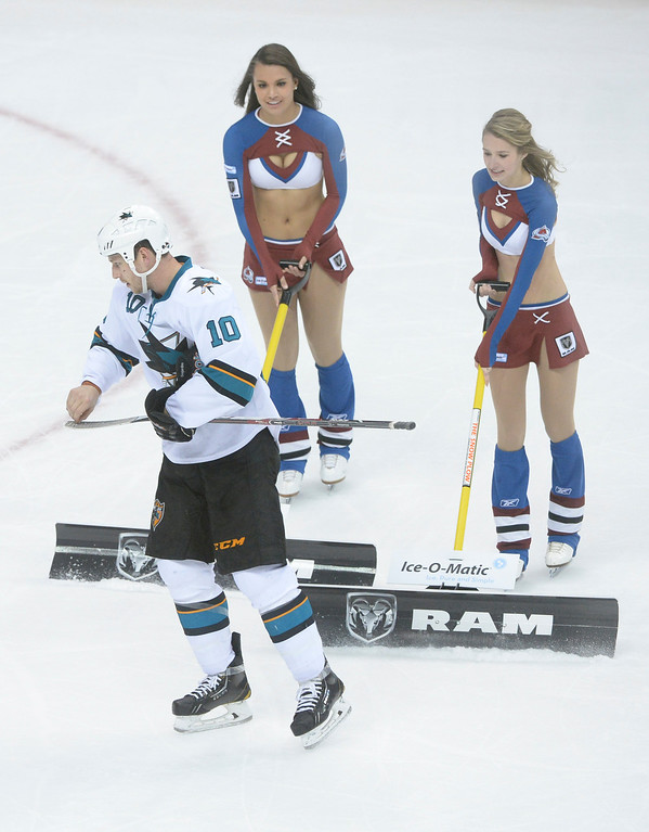 . DENVER, CO. - JANUARY 04:  San Jose center Andrew Desjardins cleaned his stick during a break in the action in the second period. The Colorado Avalanche hosted the San Jose Sharks at the Pepsi Center Saturday afternoon, January 4, 2014. Photo By Karl Gehring/The Denver Post
