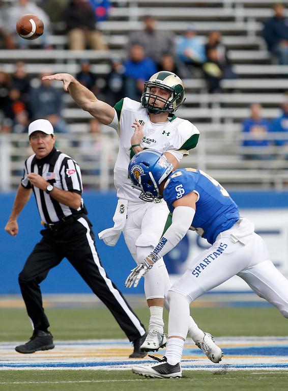 . Colorado State quarterback Garrett Grayson (18) passes against San Jose State during the first half of an NCAA college football game Saturday, Nov. 1, 2014, in San Jose, Calif. (AP Photo/Tony Avelar)