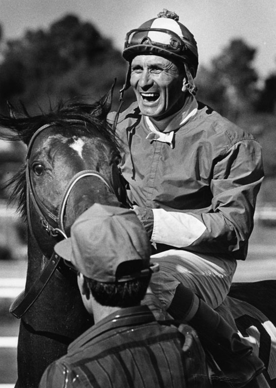 . Jockey Fernando Toro is a happy man after guiding Roi Normand to a Sunset Handicap victory at Hollywood Park\'s final running of the season.   Photograph dated August, 1988.   (Los Angeles Public Library)