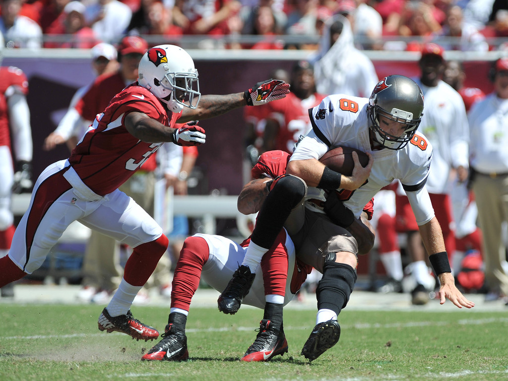 . TAMPA, FL - SEPTEMBER 29:  Safety Yeremiah Bell #37 of the Arizona Cardinals sacks quarterback Mike Glennon #8 of the Tampa Bay Buccaneers  September 29, 2013 at Raymond James Stadium in Tampa, Florida. (Photo by Al Messerschmidt/Getty Images)